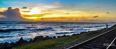 Sunset (ajanth.v) Tags: blue sunset orange beach water skyline landscape evening nikon rocks outdoor wave srilanka 1855mm colombo westernprovince d3100