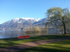 20160318_161530 (coldgazemedia) Tags: switzerland photobank stockphoto ticino locarno landscape lake lakemaggiore bluesky blue swissvillage snowmountain outdoor water waterfront sea seaside scenery mountain green red tree bench shore