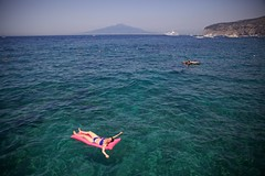 Sorrento Sea (cookedphotos) Tags: canon 5dmarkii travel italy sorrento woman girl swimming float floating swim water ocean sea vesuvius boat cruiseship