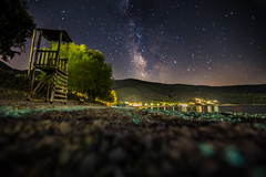 Milky Way rises over the beach (Vagelis Pikoulas) Tags: porto germeno greece europe september 2016 autumn canon 6d tokina 1628mm beach lifeguard sky night nightscape landscape view long exposure space universe galaxy stars star sea seascape rock rocks