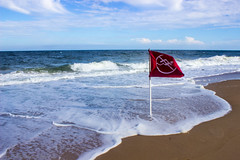 Red flag (Amy ::) Tags: shore coast foam waves surf flag noswimming rehobothbeach delaware