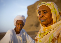 Old woman with tatooed lips, Sudan (Eric Lafforgue) Tags: africa sunset portrait woman horizontal tattoo outdoors photography couple day veiled veil northafrica soedan sudan lips karma tatoo 2people twopeople nubia adultsonly lookingaway soudan saharadesert northernafrica traditionalclothing realpeople traveldestinations colorimage kerma seniorwoman jalabiya 6837  szudn sudo  northernsudan northsudan      xuan eri6837