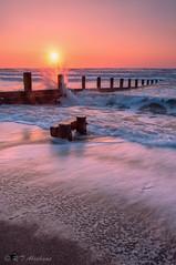 Reaching for the Sun. (RTA Photography) Tags: splash sea teignmouth sunrise orange glow white groynes tide beach 1855 waves nikond5000 daybreak morning sand surf sun sunriseoverwater gradfilter vi viveza20 lightroom4 spring