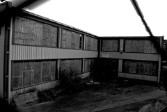 Derelict 3 (Nathan Lisher) Tags: urban blackandwhite bw white black west building architecture buildings sussex blackwhite nikon secret cctv demolition structure architectural used cropped fencing dslr derelict structural redundant shoreham shorehambysea unused derelictbuildings architecturalphotography survaillance croppped shorehamairport nikondslr nikond3000 structuralphotography