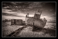 Dungeness. (tracyhughes2_7. CPAGB LRPS) Tags: wood sky clouds boat kent track shed hut dungeness netting digitalcameraclub 100commentgroup me2youphotographylevel1