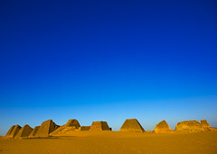 Pyramids In Royal Cemetery, Meroe, Sudan (Eric Lafforgue) Tags: africa travel sky brown history tourism archaeology nature cemetery horizontal architecture outdoors photography death sand memorial day desert pyramid northafrica soedan sudan tomb tranquility bluesky nobody nopeople unescoworldheritagesite copyspace custom sanddune ancientcivilization khartoum nubia royalty thepast scenics ruined soudan tranquilscene saharadesert northernafrica meroe traveldestinations colorimage naturalpattern beautyinnature buildingexterior fulllenght oldruin merowe aridclimate  szudn sudo  builtstructure northernsudan pyramidsofmeroe northsudan blackpharaohs      xuan eri7611