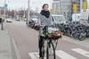 (105mm) Tags: street city people woman flower girl smile amsterdam fashion bike happy outfit women pretty style skirt fiets streetwear mensen streetfashion streetstyle flowersbicycle