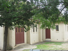 The Vestry of St Johns Anglican Church  Downey Street, Alexandra (raaen99) Tags: door roof roses flower building tree tower church window wall architecture facade garden tile concrete religious town leaf 1930s worship catholic exterior terracotta painted faith country religion entrance stjohns australia chapel victoria belltower doorway belfry alexandra porch catholicism 20thcentury grounds stainedglasswindow anglican stucco 30s 1937 anglicanchurch churchbuilding rooftile placeofworship spanishmission countryvictoria vestibule twentiethcentury countrytown hippedroof northeastvictoria religiousbuilding stjohnsanglicanchurch spanishmissionstyle spanishmissionarchitecture provincialvictoria georgepayne spanishmissionchurch terracottarooftile downeystreet architecturallydesigned lrwilliams spanishmissionbuilding downeyst alexandraanglicanchurch stjohnsalexandra theanglicanchurchofstjohn georgeapayne stuccoedconcrete