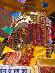 The shrine containing the Guru Granth Sahib, the Siky holy book, on a float in the 2013 Vaisakhi festival parade in Southampton (Anguskirk) Tags: uk england color colour festival shrine hampshire procession sikh gurdwara southampton float turbans vaisakhi gurugranthsahib 2013 nagarkirtan gurdrawananaksar