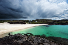 Dark Clouds Over Clachtoll Beach (Philipp Klinger Photography) Tags: ocean uk greatbritain houses light shadow sea sky woman white house storm black green beach nature water yellow rock female clouds landscape person scotland seaside sand nikon rocks angle cloudy unitedkingdom britain turquoise united hill great wide dramatic rocky kingdom wideangle stormy atlantic hills gb drama sutherland dramaticsky philipp emerald atlanticocean sco schottland d800 lochinver assynt klinger kylesku clachtoll clachtollbeach dcdead nikond800