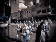 crossing blue (mugley) Tags: road street city trees sky people urban distortion trafficlights cars architecture clouds digital corner buildings walking ir crossing traffic f14 lofi australia melbourne wideangle olympus victoria pole ute shops pedestrians infrared intersection jb