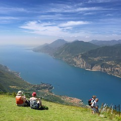 A perfect way to enjoy marvelous views of Lake Garda (Bn) Tags: camera blue summer sky italy panorama mountain lake holiday alps smile car cheese trekking garden walking polaroid milk italian topf50 garda rocks europe strada mediterranean italia photographer view cows hiking path altitude cable ridge primo edge panoramica rest hikers resting elevated peaks viewpoint fiore higher topf100 walkers mont climate breathtaking malcesine paragliders gardameer baldo 100faves 50faves panview 2218m