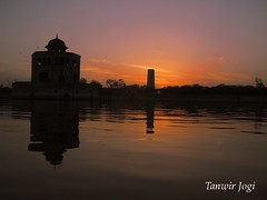 Evening Hues at Hiran Minar, Sheikhupura (Tanwir Jogi ( www.thetrekkerz.org )) Tags: travel pakistan sunset plants sun lake building nature water beautiful set architecture trekking trek reflections boats gold golden herbs adventure cannon traveling tours lahore minar treks hern naturelover mughal jogi hiran g9 sheikhupura meenar beautifulpakistan trekkinginpakistan cannong9 tanwir travelinginpakistan thetrekkerz tourisminpakistan tanwirjogi