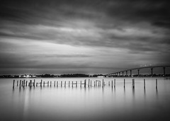 Silent Drama (jeffsmallwood) Tags: morning bridge blackandwhite water monochrome clouds sunrise patuxent solomons 52weeks cpc52 cloudysolomonsbridgecloudymorning