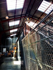 Southern Pacific Brewing Co. (chucknado) Tags: beer fence chainlink brewery skylights southernpacific uploaded:by=flickrmobile flickriosapp:filter=nofilter