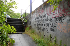 You are whatever... (jackonflickr) Tags: sun moon wet rain wall oregon stairs writing portland graffiti words paint poetry poem you spray sing whatever always damp