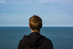Young Male Looking to Horizon Ocean Landscape Abstract (HunterBliss) Tags: abstract beautiful behind blonde blue boy clouds cut daytime determination ears flat from goals guy hair head hoody horizon innovation ireland irish jacket landscape looking man neck ocean overlooking parallel perspective portrait short sky success teen view water waves wind young