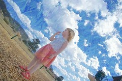 her head in the clouds (Pejasar) Tags: granddaughter birthday 3 playground estespark colorado clouds art