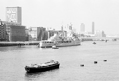HMS Belfast, circa 1980 (Ron's travel site) Tags: flickrandroidapp:filter=none riverthames london england uk gb circa1980 filmcamera olympusom10 om10 35mm ronstravelsite wwwronsspotuk hmsbelfast ship blackandwhite bw mono monochrome