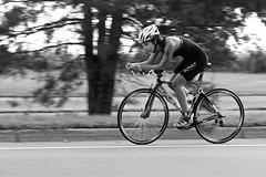 Kinky (Cathy de Moll) Tags: race triathlon rider speed bokeh fast racer female woman intense biker