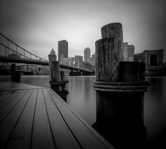 Pinhole Pittsburgh 2 (The Stugots) Tags: zero image zeroimage pinhole camera fuji film fujifilm neopan acros hc110 1to63 1 63 dilution h for 11 minutes ilford stop fixer city river pittsburgh steele bridge dock wooden no lens 120 medium format 6x7 6x9