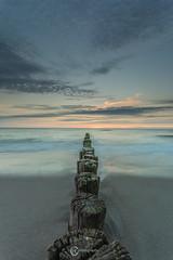 Goodbye Sun (Sicilian1976) Tags: canon6d canon1740 sea seascape holland zeeland burghhaamstede zee wolken clouds strand sunset poles