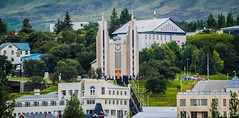2016 - CPH-NYC Cruise - Iceland, Akureyri - Lutheran Church (Ted's photos - For Me & You) Tags: 2016 cphnyccruise cropped nikon nikond750 nikonfx tedmcgrath tedsphotos vignetting akureyri akureyriiceland iceland church churchspires steps stairs people peopleandpaths clockface clock