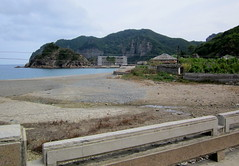 North Korea Mt. Chilbo area beach near Poch'on with homes, boats and electrified fence (moreska) Tags: travel homes tourism rooftop beach coast asia pretty mt empty rustic north scenic korea views barrier hillside seashore deserted bucolic electricfence bungalows dprk pochon chilbo