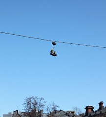 Shoes in the sky (petrri) Tags: urban abandoned shoes discarded fad