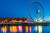 The Seattle Great Wheel on the Waterfront at Twilight (Lee Rentz) Tags: seattle park carnival usa color colour america reflections fun lights reflecting evening amusement pier washington movement twilight colorful waterfront ride northwest tourist reflected pacificnorthwest northamerica ferriswheel gondola pugetsound colourful washingtonstate visitor viewing enjoyment elliotbay greatwheel 2013 seattlegreatwheel viewingmotion