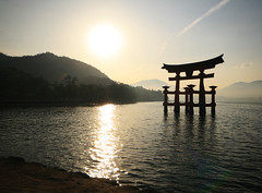 Sunset at Miyajima Island, Japan (` Toshio ') Tags: sunset cloud sun reflection water japan island bay hiroshima miyajimaisland miyajima nippon torii nihon goldenhour floatingtorii toshio