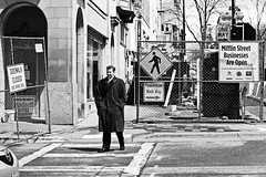 pedestrian (local paparazzi (isthmusportrait.com)) Tags: shadow people blackandwhite bw white signs man black male wet architecture contrast skyscraper standing fence bag walking prime iso100 construction pod shoes waiting closed downtown raw arch open dress pavement walk noparking curves sunny pedestrian ears demolition suit sidewalk posted access cropped manual madisonwi crosswalk curb afs wrongway torndown hirise ywca autofocus handsinpockets mifflinstreet 2013 belmonthotel tearingdown 100block nikond90 danecountywisconsin photoshopelements7 pse7 50mm14g localpaparazzi redskyrocketman lopaps 365projectalternate