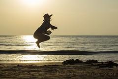 Jumping cowboy (Chrisseee) Tags: man black beach silhouette backlight jump jumping sand horizon clutter