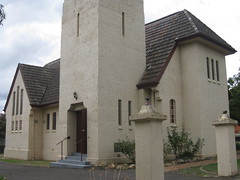 St Johns Anglican Church  Downey Street, Alexandra (raaen99) Tags: door roof roses flower building tree tower church window wall architecture facade garden tile concrete religious town leaf 1930s worship catholic exterior terracotta painted faith country religion entrance stjohns australia chapel victoria belltower doorway belfry alexandra porch catholicism 20thcentury grounds stainedglasswindow anglican stucco 30s 1937 anglicanchurch churchbuilding rooftile placeofworship spanishmission countryvictoria vestibule twentiethcentury countrytown hippedroof northeastvictoria religiousbuilding stjohnsanglicanchurch spanishmissionstyle spanishmissionarchitecture provincialvictoria georgepayne spanishmissionchurch terracottarooftile downeystreet architecturallydesigned lrwilliams spanishmissionbuilding downeyst alexandraanglicanchurch stjohnsalexandra theanglicanchurchofstjohn stuccoedconcrete