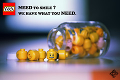 Need to smile ? We have what you need. (David TAPIN) Tags: smile canon advertising lego head humour sourire publicite flacon pilules tetes medicaments 450d 55250mm