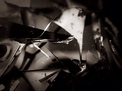 Broken (MattsLens) Tags: bw macro broken glass metal image crash parts sharp round data harddrive grandrapids dust information destroyed shards internal d