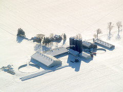 Rural farm in Southern Ontario during winter. (urbanmoon) Tags: winter snow field farm aerial farmland silo fields silos agriculture agricultural