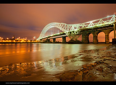 Golden Gait (Steve-P2010) Tags: longexposure bridge orange architecture night river nightlights transport wideangle nighttime le nightsky lowtide mersey runcorn widnes