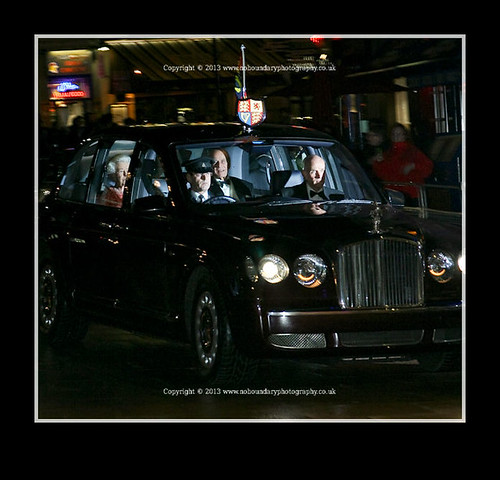 HRH Queen Elizabeth II and Duke of Edinburgh are driven in Her car-