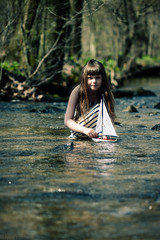 In the creek (Kilkennycat) Tags: water girl sailboat creek canon children toy boat model child sail 500d kilkennycat t1i ryanconners 100mm28l