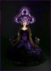 Savra sitting (sulisloveswater) Tags: lady regal hat flowers beauty purple girl seat sat black