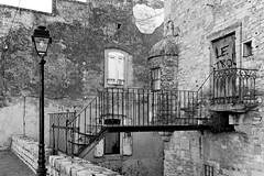 Aramon (bong.13) Tags: aramon gard pierre rverbre noiretblanc blackandwhite nikon d3200 rue ancienne france provence pierres