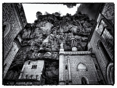 Rocamadour (Missy Jussy) Tags: rocamadour cliffs rocks trees sky france southcentralfrance architecture buildings historical holiday worship village trip travel mono monochrome blackwhite bw landscape canon canonpowershotsx60 monastery shadows light