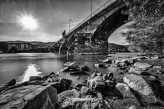 at the bridge II (Zesk MF) Tags: bw black white zesk trier mosel river flus nd filter nd1000 sigma 8mm nikon rocks water flow longtime langzeitbelichtung bridge ancient roman rmerbrcke sun sky treves nature city