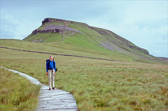 the beast conquered (Ron Layters) Tags: penyghent ronet thebeast path boardwalk pennineway hill cliffs moorland threepeaks yorkshiredales landscape day11 hortoninribblesdale england unitedkingdom slidefilmthenscanned slide transparency fujichrome velvia canoneos300v canon eos300v rebelti ronlayters