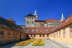 The Gardener - Akershus Fortress in Oslo (Maria_Globetrotter) Tags: park city travel flowers summer flower tower castle history tourism oslo norway stone museum canon garden norge colorful day military capital norwegen august visit best norwegian clear prison area torn fjord sten akershus festning historia stad oslofjord 2012 sommar trdgrd lightroom fjorden slott fstning munks 550d akerhus 1585 quisling vidkun kongeborg renessansen middelaldersk mariaglobetrotter