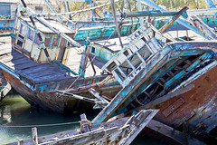 Boat Graveyard India (arfabita) Tags: texture industry water colors horizontal river landscape boat colorful ship sundown background flag indian flags estuary business crew repair concept conceptual shipping salvage breezy reparing gujarat boatyard engineers seacraft outofservice woodenboats scrapped servicing shipwrecked boatrepair boatgraveyard boatrepairs