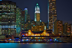 Pier 17 and the Woolworth Building, NYC (SunnyDazzled) Tags: park city nyc longexposure newyork reflection building water skyline brooklyn night skyscraper river lights bay colorful cityscape view manhattan southstreetseaport woolworth pier17 takenin3layers