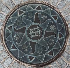 Emblem Americas (Jane Inman Stormer) Tags: park ohio sun metal emblem turtle cincinnati plate ground sidewalk symbols hipbotunsquare