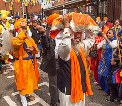 Carrying the Guru Granth Sahib, the Siky holy book, in the 2013 Vaisakhi festival parade in Southampton (Anguskirk) Tags: uk england color colour festival hampshire procession sikh gurdwara southampton turbans saris vaisakhi gurugranthsahib 2013 nagarkirtan gurdrawananaksar
